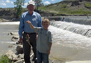 Tom Berry with Grandchildren fishing
